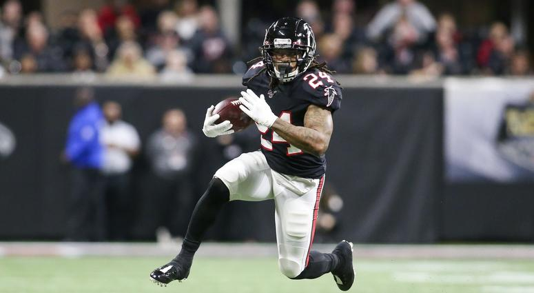 Nov 28, 2019; Atlanta, GA, USA; Atlanta Falcons running back Devonta Freeman (24) runs the ball against the New Orleans Saints in the first half at Mercedes-Benz Stadium. Mandatory Credit: Brett Davis-USA TODAY Sports