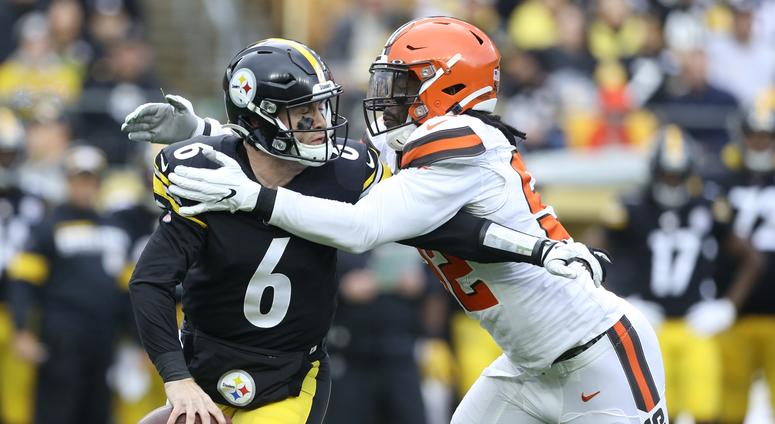 Dec 1, 2019; Pittsburgh, PA, USA; Pittsburgh Steelers quarterback Devlin Hodges (6) is sacked by Cleveland Browns defensive end Chad Thomas (92) during the first quarter at Heinz Field. Mandatory Credit: Charles LeClaire-USA TODAY Sports