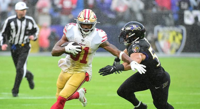Dec 1, 2019; Baltimore, MD, USA; San Francisco 49ers running back Raheem Mostert (31) runs with the ball while being pursued by Baltimore Ravens linebacker L.J. Fort (58) in the second quarter at M&T Bank Stadium. Mandatory Credit: Evan Habeeb-USA TODAY S