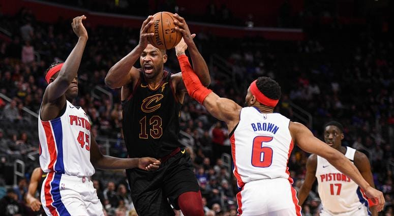 Cleveland Cavaliers center Tristan Thompson (13) drives to the basket against Detroit Pistons forward Sekou Doumbouya (45) and guard Bruce Brown (6) during the fourth quarter at Little Caesars Arena.