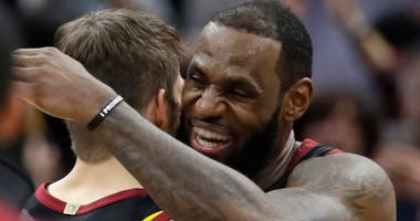 Cleveland Cavaliers' LeBron James, right, hugs Kyle Korver after hitting the game-winning shot to defeat the Toronto Raptors 105-103 in Game 3 of an NBA basketball second-round playoff series, Saturday, May 5, 2018, in Cleveland.