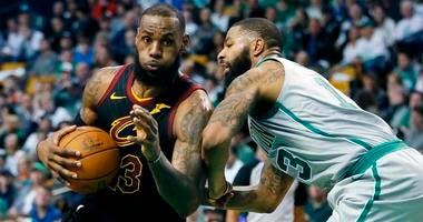 In this Feb. 11, 2018, file photo, Cleveland Cavaliers' LeBron James (23) drives against Boston Celtics' Marcus Morris (13) during the third quarter of an NBA basketball game in Boston. Although there were long stretches when it seemed impossible that the