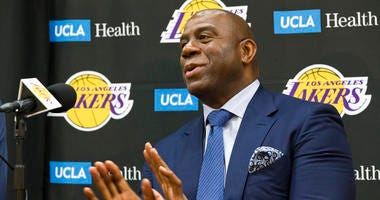 Magic Johnson is betting his job on his free-agent recruiting skills for the Los Angeles Lakers. Johnson says he will step down as the Lakers' president of basketball operations if he can't persuade an elite free agent to sign with his club
