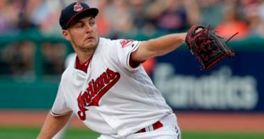 Cleveland Indians starting pitcher Trevor Bauer delivers in the first inning of a baseball game against the Minnesota Twins, Monday, Aug. 6, 2018, in Cleveland.