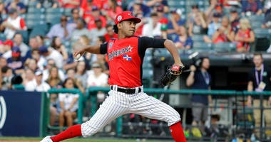 Deivi Garcia, of the New York Yankees, throws during the first inning of the MLB All-Star Futures baseball game, Sunday, July 7, 2019, in Cleveland. The MLB baseball All-Star Game is to be played Tuesday. (AP Photo/Darron Cummings)