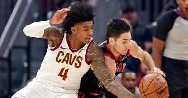 Cleveland Cavaliers' Kevin Porter Jr. (4) and Chicago Bulls' Ryan Arcidiacono (51) compete for the ball during the first half of an NBA basketball game Wednesday, Oct. 30, 2019, in Cleveland. (AP Photo/Tony Dejak)