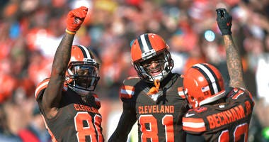 Cleveland Browns wide receiver Jarvis Landry (80) celebrates with Cleveland Browns wide receiver Odell Beckham Jr. (13) and wide receiver Rashard Higgins (81) after Landry scored a 7-yard touchdown during the first half of an NFL football game against the