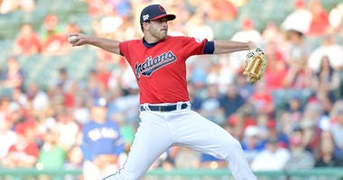CLEVELAND, OHIO - AUGUST 05: Starting pitcher Aaron Civale #67 of the Cleveland Indians pitches during the first inning against the Texas Rangers at Progressive Field on August 05, 2019 in Cleveland, Ohio. (Photo by Jason Miller/Getty Images)