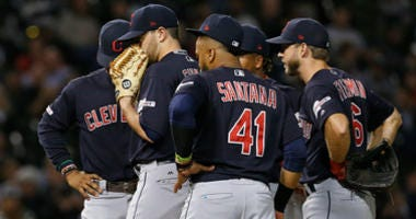CHICAGO, ILLINOIS - SEPTEMBER 26: Aaron Civale #67 of the Cleveland Indians stands on the mound with teammates during the fourth inning of a game against the Chicago White Sox at Guaranteed Rate Field on September 26, 2019 in Chicago, Illinois. (Photo by