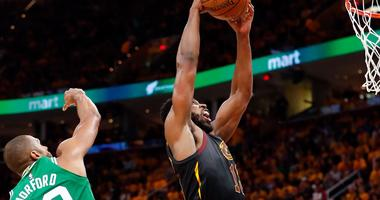 May 19, 2018; Cleveland, OH, USA; Cleveland Cavaliers center Tristan Thompson (13) rebounds the ball in front of Boston Celtics forward Al Horford (42) during the second half in game three of the Eastern conference finals of the 2018 NBA Playoffs at Quick