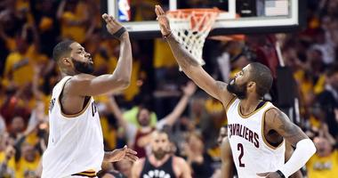 May 1, 2017; Cleveland, OH, USA; Cleveland Cavaliers center Tristan Thompson (13) and guard Kyrie Irving (2) celebrate a basket during the second half Toronto Raptors in game one of the second round of the 2017 NBA Playoffs at Quicken Loans Arena. Mandato