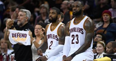 Cleveland Cavaliers guard Kyrie Irving (2) and forward LeBron James (23) during the second quarter in game four of the 2017 NBA Finals against the Golden State Warriors at Quicken Loans Arena.