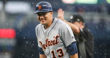Detroit Tigers first base coach Omar Vizquel (13) reacts in the rain in the seventh inning against the New York Yankees at Yankee Stadium.