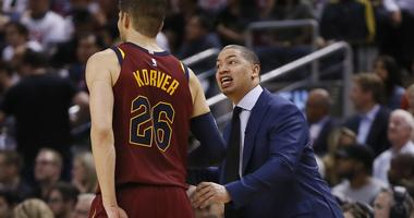 Cavaliers coach Tyronn Lue talks to guard Kyle Korver (26) during a break in the action against the Toronto Raptors during game one of the second round of the 2018 NBA Playoffs at Air Canada Centre.
