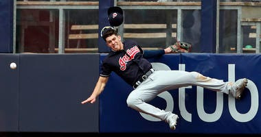 May 5, 2018; Bronx, NY, USA; Cleveland Indians center fielder Bradley Zimmer (4) collides with the wall attempting to catch a double by New York Yankees catcher Austin Romine (28) during the seventh inning at Yankee Stadium.