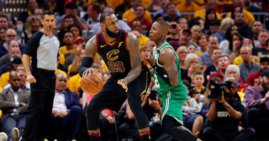 May 19, 2018; Cleveland, OH, USA; Cleveland Cavaliers forward LeBron James (23) drives against Boston Celtics guard Terry Rozier (12) in game three of the Eastern conference finals of the 2018 NBA Playoffs at Quicken Loans Arena.