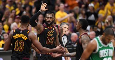 Cavaliers forward LeBron James (23) high-fives center Tristan Thompson (13) in front of Boston Celtics forward Al Horford (42) during the third quarter in game four of the Eastern conference finals of the 2018 NBA Playoffs at Quicken Loans Arena