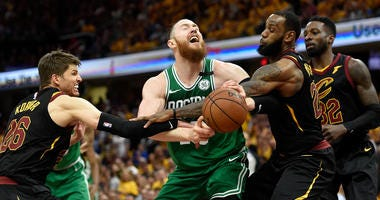 Boston Celtics center Aron Baynes (46) is fouled by Cleveland Cavaliers guard Kyle Korver (26) in front of forward LeBron James (23) and Cleveland Cavaliers forward Jeff Green (32) during the forth quarter in game four of the Eastern conference finals of