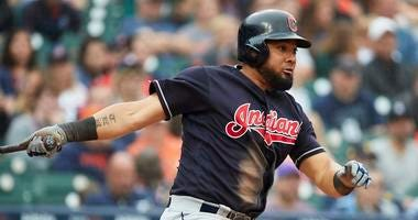 Jun 10, 2018; Detroit, MI, USA; Cleveland Indians left fielder Melky Cabrera (53) hits an RBI single in the eighth inning against the Detroit Tigers at Comerica Park.
