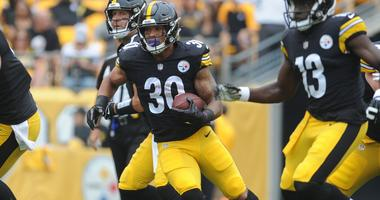 Pittsburgh Steelers running back James Conner (30) picks up short yards in the first quarter against the Tennessee Titans at Heinz Field