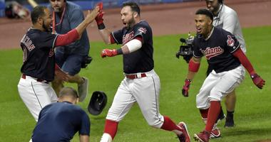 Cleveland Indians center fielder Jason Kipnis (22) celebrates his game-winning grand slam with designated hitter Edwin Encarnacion (10) and shortstop Francisco Lindor (12) in the ninth inning against the Chicago White Sox at Progressive Field.