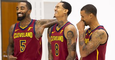 Cleveland Cavaliers guard J.R. Smith (5) and guard Jordan Clarkson (8) laugh along with guard George Hill (3) during Cavs Media Day at Cleveland Clinic Courts.