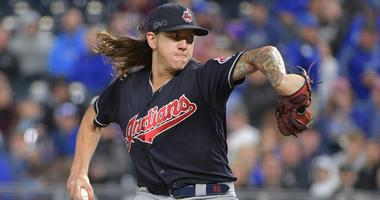 Sep 28, 2018; Kansas City, MO, USA; Cleveland Indians starting pitcher Mike Clevinger (52) delivers a pitch in the first inning against the Kansas City Royals at Kauffman Stadium. Mandatory Credit: Denny Medley-USA TODAY Sports