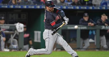 Cleveland Indians third baseman Josh Donaldson (27) connects for a double in the seventh inning against the Kansas City Royals at Kauffman Stadium.