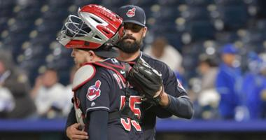 Sep 28, 2018; Kansas City, MO, USA; Cleveland Indians relief pitcher Adam Plutko (45) is congratulated by catcher Roberto Perez (55) after the win over the Kansas City Royals at Kauffman Stadium. Cleveland won 14-6. Mandatory Credit: Denny Medley-USA TODA