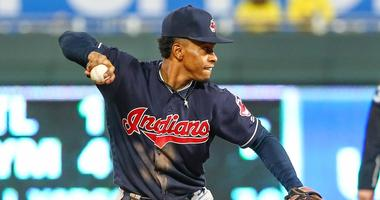 Cleveland Indians shortstop Francisco Lindor (12) throws to first base against the Kansas City Royals at Kauffman Stadium.