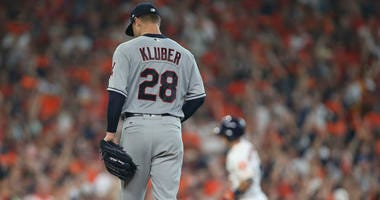 Oct 5, 2018; Houston, TX, USA; Cleveland Indians starting pitcher Corey Kluber (28) reacts after Houston Astros third baseman Alex Bregman (2) hit a solo home run during the fourth inning in game one of the 2018 ALDS playoff baseball series at Minute Maid