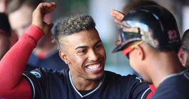 Oct 8, 2018; Cleveland, OH, USA; Cleveland Indians shortstop Francisco Lindor (12) celebrates a play with left fielder Michael Brantley (23) third inning against the Houston Astros during game three of the 2018 ALDS playoff baseball series at Progressive