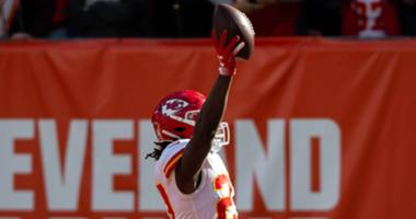 Kansas City Chiefs running back Kareem Hunt (27) runs the ball into the end zone for a touchdown against the Cleveland Browns during the first quarter at FirstEnergy Stadium.