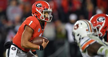 Nov 10, 2018; Athens, GA, USA; Georgia Bulldogs quarterback Justin Fields (1) runs against the Auburn Tigers during the fourth quarter at Sanford Stadium. Mandatory Credit: Dale Zanine-USA TODAY Sports