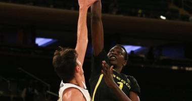 Oregon Ducks center Bol Bol (1) shoots against Iowa Hawkeyes forward Luka Garza (55) during the second half at Madison Square Garden.