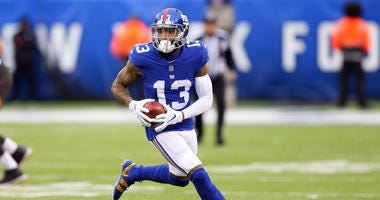 Nov 18, 2018; East Rutherford, NJ, USA; New York Giants wide receiver Odell Beckham (13) gains yards after catch during the second half against the Tampa Bay Buccaneers at MetLife Stadium. Mandatory Credit: Vincent Carchietta-USA TODAY Sports
