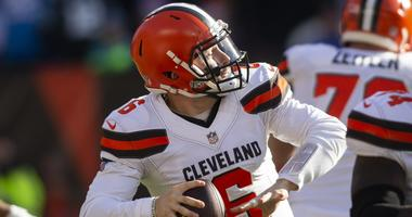 Cleveland Browns quarterback Baker Mayfield (6) throws a pass for a first down against the Carolina Panthers during the first quarter at FirstEnergy Stadium.
