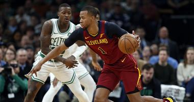 Jan 23, 2019; Boston, MA, USA; Cleveland Cavaliers guard Rodney Hood (1) is guarded by Boston Celtics guard Terry Rozier (12) during the first half at TD Garden. Mandatory Credit: Greg M. Cooper-USA TODAY Sports