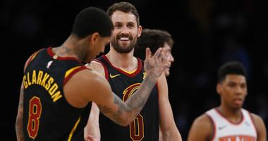 Feb 28, 2019; New York, NY, USA; Cleveland Cavaliers forward Kevin Love (0) and Cleveland Cavaliers guard Jordan Clarkson (8) celebrate during the second half against the New York Knicks at Madison Square Garden. Mandatory Credit: Noah K. Murray-USA TODAY