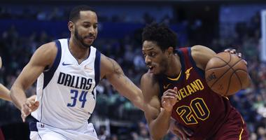 Mar 16, 2019; Dallas, TX, USA; Cleveland Cavaliers guard Brandon Knight (20) drives to the basket as Dallas Mavericks guard Devin Harris (34) defends during the first half at American Airlines Center. Mandatory Credit: Kevin Jairaj-USA TODAY Sports