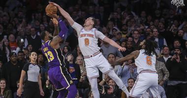Mar 17, 2019; New York, NY, USA; New York Knicks forward Mario Hezonja (8) blocks Los Angeles Lakers forward LeBron James (23) shot at the buzzer in the Knicks 124-123 victory at Madison Square Garden. Mandatory Credit: Wendell Cruz-USA TODAY Sports