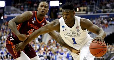 Duke Blue Devils forward Zion Williamson (1) drives to the basket against Virginia Tech Hokies guard Ty Outlaw (42) during the first half in the semifinals of the east regional of the 2019 NCAA Tournament at Capital One Arena.