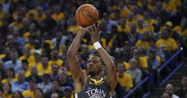 April 30, 2019; Oakland, CA, USA; Golden State Warriors forward Alfonzo McKinnie (28) shoots the basketball against the Houston Rockets during the third quarter in game two of the second round of the 2019 NBA Playoffs at Oracle Arena. The Warriors defeate