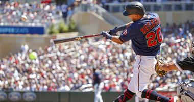 Minnesota Twins designated hitter Eddie Rosario (20) hits a three run home run against the Chicago White Sox in the third inning at Target Field.