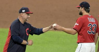Jun 25, 2019; Cleveland, OH, USA; Cleveland Indians manager Terry Francona (77) takes the ball from relief pitcher Brad Hand (33) during a pitching change in the ninth inning against the Kansas City Royals at Progressive Field. Mandatory Credit: David Ric