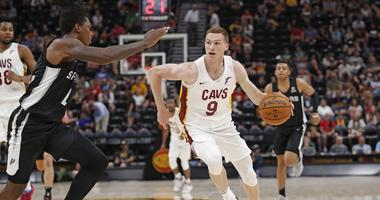 Jul 1, 2019; Salt Lake City, UT, USA; Cleveland Cavaliers Dylan Windler (9) drives against San Antonio Spurs Lonnie Walker IV (1) in the third quarter at Vivint Smart Home Arena. Mandatory Credit: Jeff Swinger-USA TODAY Sports