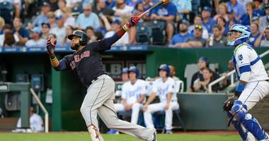 Cleveland Indians first baseman Carlos Santana (41) follows through on a swing for a home run in the fourth inning against the Kansas City Royals at Kauffman Stadium.