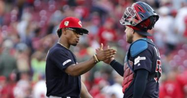Jul 6, 2019; Cincinnati, OH, USA; Cleveland Indians shortstop Francisco Lindor (left) and catcher Roberto Perez (55) react after the Indians defeated the Cincinnati Reds at Great American Ball Park. Mandatory Credit: David Kohl-USA TODAY Sports