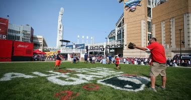 Jul 8, 2019; Cleveland, OH, USA; Fans play catch outside the gates prior to the workouts before the 2019 MLB Home Run Derby at Progressive Field. Mandatory Credit: Charles LeClaire-USA TODAY Sports