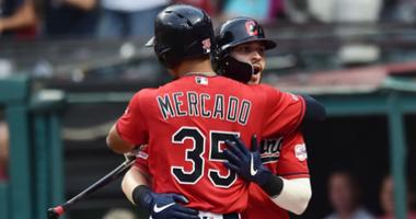 Jul 19, 2019; Cleveland, OH, USA; Cleveland Indians right fielder Tyler Naquin (30) celebrates with center fielder Oscar Mercado (35) after hitting a home run during the third inning against the Kansas City Royals at Progressive Field. Mandatory Credit: K